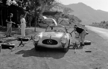The Kling/Klenk team at a pit stop of the 1952 Carrera Panamericana, shortly after a vulture crashed through the windscreen injuring Hans Klenk. The crew has not mounted bars to protect the screen yet.