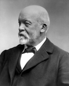 "Gottlieb Daimler at an advanced age. By the end of 1883, he and Wilhelm Maybach develop a small, high-speed internal combustion engine with an uncontrolled hot-tube ignition system ready for patenting. The next test engine, referred to as the ""Grandfather-Clock Engine"" due to its resemblance to pendulum clocks, is the final breakthrough in 1884 and appears in various stages of development in the so-called ""Reitwagen"", in the Daimler Motor Carriage and in various boats."