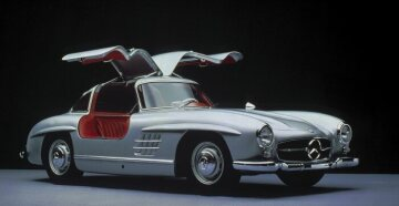 "After WWII, the Mercedes-Benz 300 SL ""Gullwing"" - often referred to as a design icon – stood for elegance and sportiness like no other car of its time. The 300 SL designed by Friedrich Geiger not only fascinated the public at its launch in 1954 due to its gullwing doors, which had to be included for construction-related reasons, but it was also the first Mercedes-Benz road car without a vertical radiator grille. Instead, there is a horizontal air intake with the Mercedes star in the centre – a design element which can be seen in many Mercedes-Benz models even today."